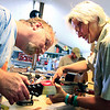 Instructor Dan Roberts, at left, helps Carissa Chappellet finish making her traveling guitar at the Rocky Grass Academy at Planet Bluegrass Ranch in Lyons on Thursday, July 22.<br /> Greg Lindstrom / The Camera