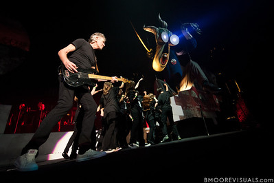 """Roger Waters performs with a group of schoolchildren as they attack """"The Schoolmaster"""" during his """"The Wall Live"""" tour on November 16, 2010 at St. Pete Times Forum in Tampa, Florida"""