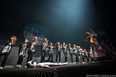 """A group of schoolchildren perform during Roger Waters' """"The Wall Live"""" tour on November 16, 2010 at St. Pete Times Forum in Tampa, Florida"""