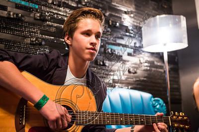 WEST HOLLYWOOD, CA - SEPTEMBER 02:  Singer Ryan Beatty warms up backstage at The Roxy Theatre on September 2, 2012 in West Hollywood, California.  (Photo by Chelsea Lauren/WireImage)