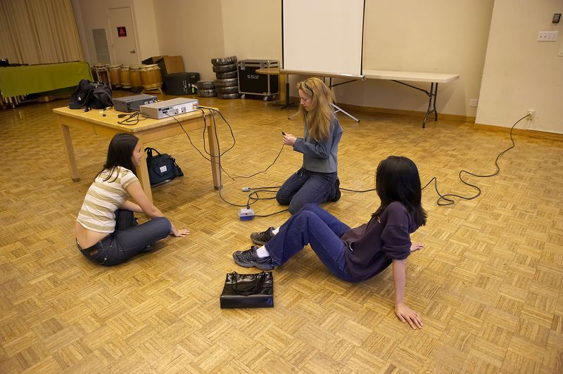 Charlotte Lai, Lesley Robertson, and Sabrina Lee lament over a broken power cord