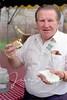Tom Clancy enjoying an American hot dog, 1990.