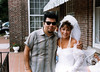 Cesar Rojas of Los Lobos poses with bride at Viking Hotel before the festival gig.