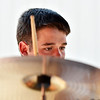 Matt Larghi, 17, plays the drums with a student band at the opening of the Broomfield School of Rock on Friday.<br /> August 10, 2012<br /> staff photo/ David R. Jennings
