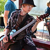 Bryce Riffle, 13, strums his guitar while waiting for his turn to play at the opening of the Broomfield School of Rock on Friday.<br /> August 10, 2012<br /> staff photo/ David R. Jennings
