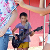 Isabella Armano, 10, plays a guitar in a student band at the opening of the Broomfield School of Rock on Friday.<br /> August 10, 2012<br /> staff photo/ David R. Jennings