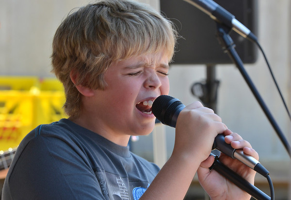 Ethan Oliver, 11, sings with a student band at the opening of the Broomfield School of Rock on Friday.<br /> August 10, 2012<br /> staff photo/ David R. Jennings