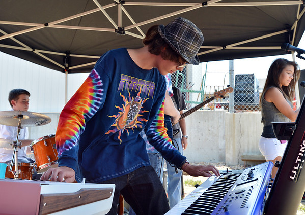 David David Vandermeer, 16, plays keyboards with a student band at the opening of the Broomfield School of Rock on Friday.<br /> August 10, 2012<br /> staff photo/ David R. Jennings