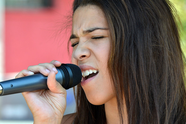 Halle Tomlison, 14, sings with a student band at the opening of the Broomfield School of Rock on Friday.<br /> August 10, 2012<br /> staff photo/ David R. Jennings
