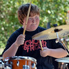 Carter Maher, 13, plays the drums for a student band at the opening of the Broomfield School of Rock on Friday.<br /> August 10, 2012<br /> staff photo/ David R. Jennings