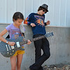 Isabella Armano, 10, left, plays her guitar while fellow student David Vandermeer, 16, listens at the opening of the Broomfield School of Rock on Friday.<br /> August 10, 2012<br /> staff photo/ David R. Jennings