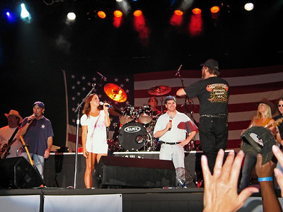 Lee Greenwood, Sara Evans, Sean Hannity and Hank Williams Jr  on stage at Six Flags Great Adventure in 2006 for the Sean Hannity Freedom Rally.