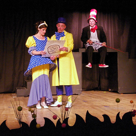 """Mrs. Mayor (Jamie Conway) and Mr. Mayor (Judge Morton) investigate a solution the their daughter JoJo's unusual """"Thinks"""" as  the Cat in the Hat (Eddie Franklin) looks on."""