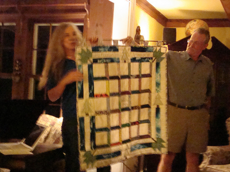 "Sue Eckler-Kerns and Jerry Kerns present the ""Summer Wind Cotton Dress"" quilt to Richard to begin the 3-day event."