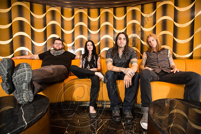 FORT LAUDERDALE, FL - NOVEMBER 27:  (L-R) Bassist Matt Beal, vocalist Sarah Anthony, guitarist Mark Anthony and drummer Taylor Carroll of The Letter Black pose onboard Shiprocked! cruise on November 27, 2012 in Fort Lauderdale, Florida.  (Photo by Chelsea Lauren/Getty Images)