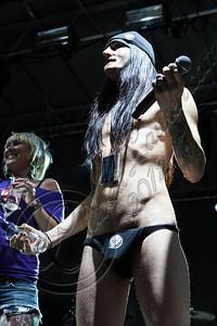 FORT LAUDERDALE, FL - NOVEMBER 27:  DJ Shannon Gunz (L) and bassist Matt DiRito of Pop Evil speak onboard Shiprocked! cruise on November 27, 2012 in Fort Lauderdale, Florida.  (Photo by Chelsea Lauren/Getty Images)