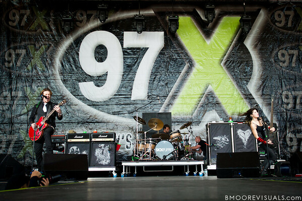 Shimon Moore, Mark Goodwin, and Emma Anzai of Sick Puppies perform on December 5, 2010 during 97X Next Big Thing at 1-800-ASK-GARY Amphitheatre in Tampa, Florida