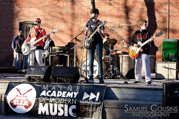 A kids band, part of the Maine Academy of Modern Music, playing in Congress Square during the First Friday Art Walk