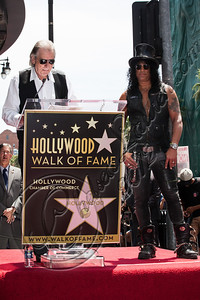 HOLLYWOOD, CA - JULY 10:  DJ Jim Ladd (L) and guitarist Slash attend Slash's Hollywood Walk of Fame ceremony on July 10, 2012 in Hollywood, California.  (Photo by Chelsea Lauren/WireImage)
