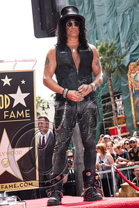 HOLLYWOOD, CA - JULY 10:  Guitarist Slash is honored with a star on the Hollywood Walk of Fame on July 10, 2012 in Hollywood, California.  (Photo by Chelsea Lauren/WireImage)