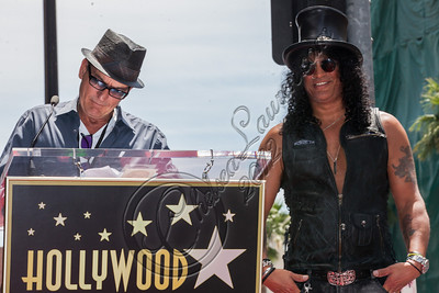 HOLLYWOOD, CA - JULY 10:  Actor Charlie Sheen (L) and guitarist Slash attend Slash's Hollywood Walk of Fame ceremony on July 10, 2012 in Hollywood, California.  (Photo by Chelsea Lauren/WireImage)