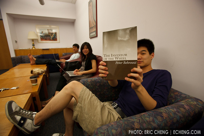 "William Joo holds up Peter Behroozi's book, ""The Inventor of the Wheel."" (SLSQ Summer Chamber Music Seminar 2010)"