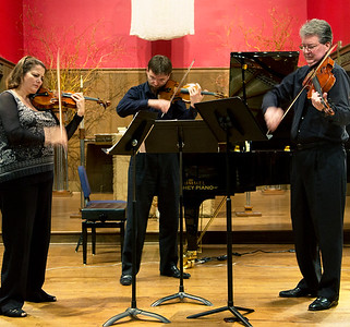 Silvia, Oleg, and James rehearse the Koldaly Serenade for Two  Violins and Viola.