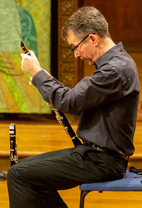 Christian Schubert cleaning his clarinet
