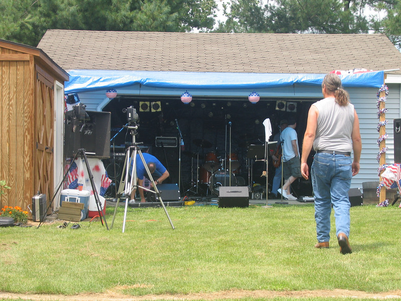 Set'n up at Russ's Block Party. Buster to the left, Doug in the garage w/Ed, and Rusty head'n there.