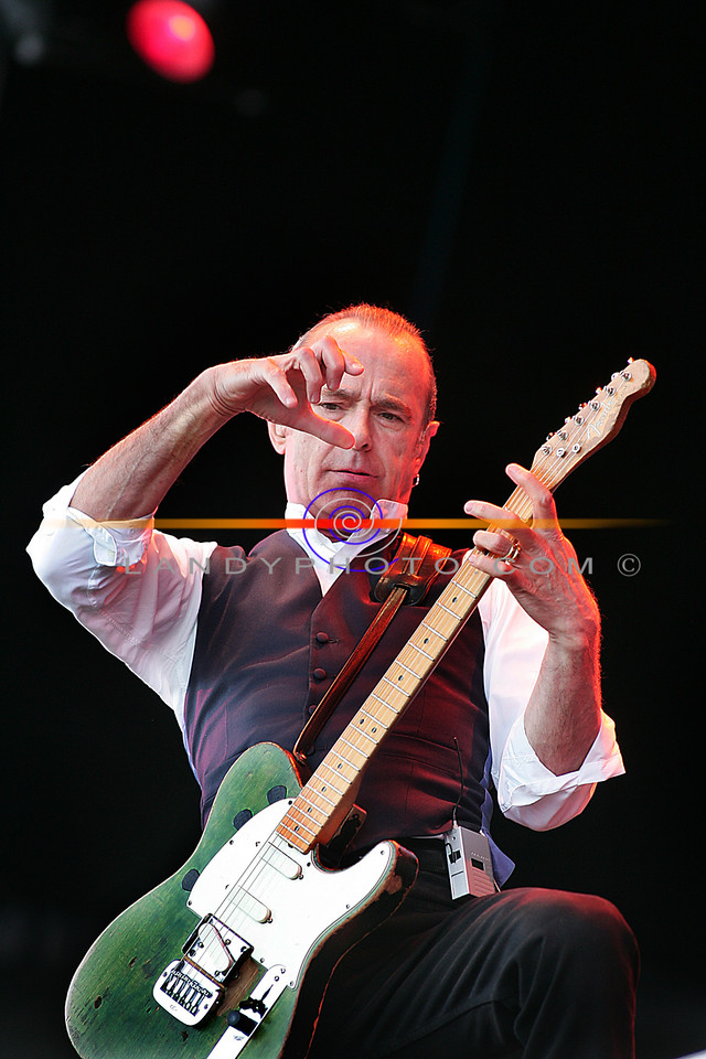 Status Quo's Francis Rossi intensivly plays his guitar and entertains the croud at Fitzgearld Stadium in Killarney at the Summer Fest.<br /> Photo Brendan Landy