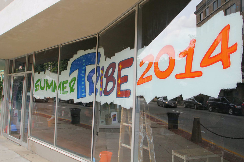 Kick off of summerTribe 2014 put on by wil Darcangelo started up on Tuesday on Main Street in Fitchburg. This is the third year for this summer program. The program painted the window of the empty store front in the building they are using for the program on Main Street. SENTINEL & ENTERPRISE/JOHN LOVE