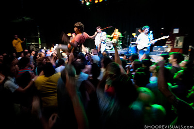 A fan goes body surfing during Surfer Blood's performance on September 19, 2010 at State Theatre in St. Petersburg, Florida.