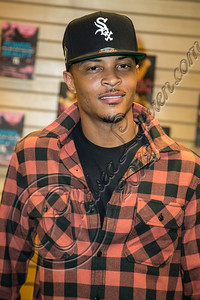 "SANTA MONICA, CA - OCTOBER 01:  Rapper Tip ""T.I."" Harris signs copies of his book ""Trouble & Triumph"" at Barnes & Noble 3rd Street Promenade on October 1, 2012 in Santa Monica, California.  (Photo by Chelsea Lauren/WireImage)"