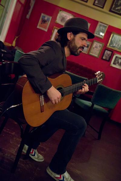 Jacob Gurevitch ,profile,playing classic spanish guitar at Tango y Vinos, Copenhagen.<br /> Color Photo.