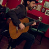 Jacob Gurevitch ,profile,playing classic spanish guitar at Tango y Vinos, Copenhagen.<br /> Color Photo.