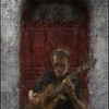 "Music Door. Allan Sjølin of the  <a href=""http://da-dk.facebook.com/pages/Copenhagen-Guitar-Duo/114896725207016?sk=info"">Copenhagen Guitar Duo</a>. Photo painted with digital sargent brush in Corel Painter + texture layers. By digital manipulation the guitarist has been placed in front of a beautiful door opposite the Tango y Vinos bar."