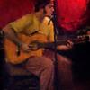 "Brazillian Klan.<br /> Brazillian guitarist Luiz Mura at ""Tango y Vinos"" bar, Copenhagen, Denmark.<br /> Photo painted with digital impressionist chalk brush in Corel Painter + texture layers."
