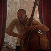 """Light Bass.<br /> Jakob Roland Hansen in """"Tango & Vinos"""" bar.<br /> Photo painted with digital wet smeary oil brush + textures in Corel Painter."""