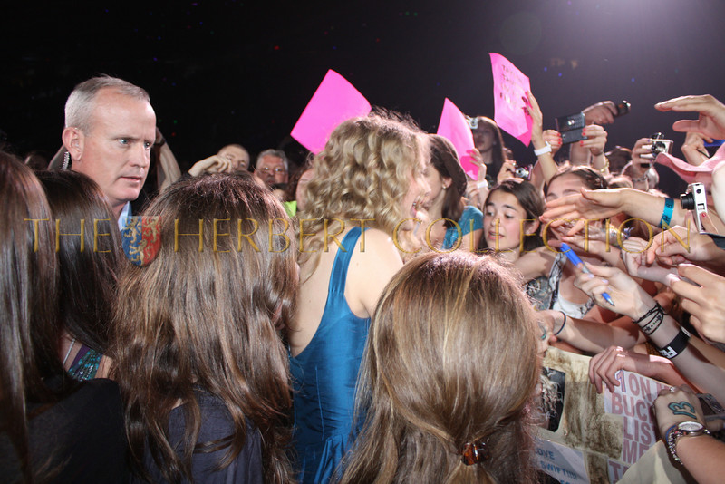 Taylor Swift greets fans from inside friends and family area