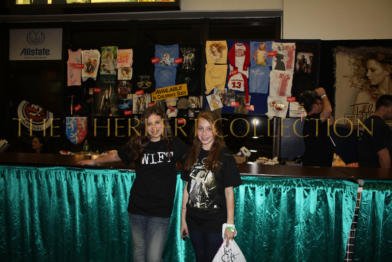 Alana Galloway and Lauren Gimpel buy their Taylor Swift Merchandise, Nassau Coliseum, May 15, 2010.