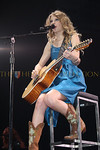 "Taylor Swift Fearless Tour,  Nassau Coliseum, May 15, 2010 : Taylor Swift Embraces Fans with More than Her Music  May 15th, 2010. Nassau Coliseum, NY. Taylor Swift embraced the crowd with her music and and her hugs as she showed up at various areas in the sold out arena's audience to get up close and personal with her fans. I've never seen this done at a large venue before. She really gave us a 'down home' feeling. It was a magical experience for fans to be so close to Taylor. People shrieked with delight as she walked through the designated areas hugging and greeting them while singing; some girls were overcome with tears of joy. Taylor exudes a genuine warmth, as if she is one's best girlfriend. She is gentle yet strong and fearless.   My daughter, Alana Galloway invited her friend Lauren Gimpel. The girls were fortunate enough to be seated in an enclosed area with about a dozen teens for some of the concert. We watched in awe as Taylor performed a few feet from us on a revolving stage. Taylor opened, ""Fifteen"" stating, ""One day, when I was six years old, I asked my guitar teacher about playing a twelve string guitar. He looked at me and said, you don't have to worry about that your hands will never be big enough to play a twelve string guitar."" She then began to play ""Fifteen"" on her 12 string guitar with undeniable skill. The crowd roared with enthusiasm. This was one of the many empowering messages of confidence that Taylor conveyed during her show. I think she is a great role model for youth. She is inspirational, teaching confidence and positive self esteem through her music.  Alana Galloway said, ""Taylor Swift has been my favorite singer for a couple of years because of her undeniably incredible singing talent and the message she sends through it. Even I, a twelve-year-old kid, can see the honest confidence she fills people with, and seeing this concert only confirmed my thoughts. Taylor Swift is truly amazing, as was her concert. I had an incredible time and am sure that even if I live to be one million, I will never, ever forget this night.""  Lauren Gimpel stated, ""This concert was exciting and very meaningful to me because Taylor is a beautiful and talented singer who is also a wonderful person. She's a great role model for us. The songs she writes about herself represent a real girl's experience, and inspires teens all over the world to be themselves, and to be ""Fearless.""  Gary Herman of New York City, parent of a twelve year old boy named Teddy brought 5 children (boys and girls) to Saturday night's concert.  He said, ""We all loved the show. Taylor's music is not only wholesome but enjoyable for kids and adults. We can't wait to see her next concert.""    Taylor Swift performed to sold out crowds in Newark, New Jersey's Prudential Center and Nassau Coliseum in Uniondale, NY during her Fearless tour which began in Brisbane Australia on Feb 4th, 2010 and will end on July 10th in Canada.  Taylor's tour is appropriately titled ""Fearless.""  She is very successful conveying that message, telling her fans, "" I love you like I love my sparkly dresses."" We love you too Taylor. Keep up the good work and please come back to New York soon.  Story and Photos Sara Herbert-Galloway and Alana Galloway www.herbertcollection.com"