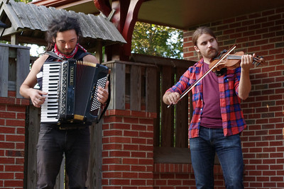 Ian Griffiths, accordian, and Patrick M'Gonigle, violin, of the Tequila Mockingbird Orchestra, playing a house concert in Mountain View, Missouri, September 8, 2011.