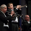 Thayer Symphony Orchestra Maestro J. Roderick MacDonald (center) performs Bugler's Holiday with fellow trumpet soloists Bruce Hopkins and and Richard Given during the 'Tribute to our Vetrans' Saturday night at Dukakis Auditorium at Monty Tech. SENTINEL & ENTERPRISE / Jim Marabello