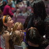 Leominster's Whitney Doucette is mobbed by young fans during the intermission of the Thayer Symphony Orchestra's 'Tribute to our Vetrans' program at Dukakis Auditorium at Monty Tech on Saturday night. SENTINEL & ENTERPRISE / Jim Marabello