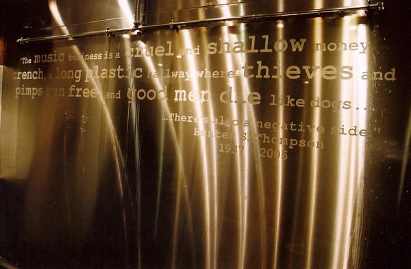 Glasgow, Scotland.  Hunter S. Thompson quote at a urinal.