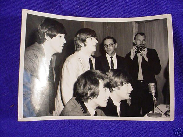 Snapshot made at the Beatles press conference in K.C., Mo. 1964. The photographer in the background is Dale Monaghen, UPI Newspictures. Photographer unknown.