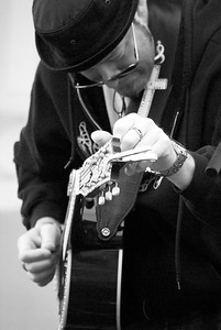 Tuning the Guitar ~ black and white