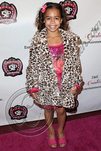 LOS ANGELES, CA - DECEMBER 15:  Dancer / television personality Asia Monet Ray arrives at the 5 Little Princesses music showcase at Studio Instrument Rentals, Inc. on December 15, 2012 in Los Angeles, California.  (Photo by Chelsea Lauren/WireImage)