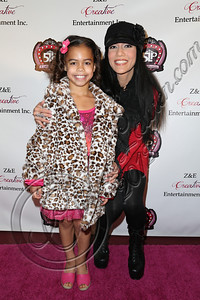 LOS ANGELES, CA - DECEMBER 15:  Dancer / television personality Asia Monet Ray (L) and mother Kristie Ray arrive at the 5 Little Princesses music showcase at Studio Instrument Rentals, Inc. on December 15, 2012 in Los Angeles, California.  (Photo by Chelsea Lauren/WireImage)