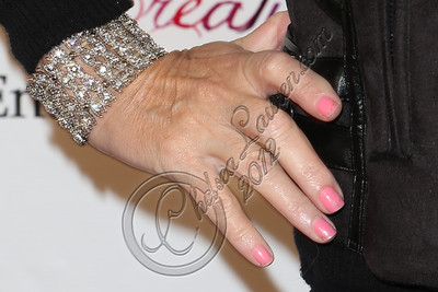 LOS ANGELES, CA - DECEMBER 15:  Host Leslie Birkland (jewelry detail) arrives at the 5 Little Princesses music showcase at Studio Instrument Rentals, Inc. on December 15, 2012 in Los Angeles, California.  (Photo by Chelsea Lauren/WireImage)